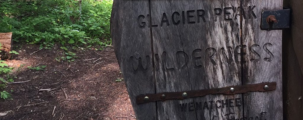 Entering Glacier Peak Wilderness with blue skies and high spirits.