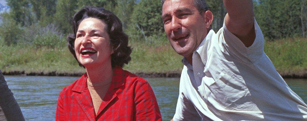 """First Lady Claudia """"Lady Bird"""" Johnson floats the Snake River near the Teton Range with Secretary of the Interior Stewart Udall. This 1964 raft trip helped influence President Lyndon Johnson's decision two years later to push legislation establishing the PCT as one of the first two national scenic trails."""