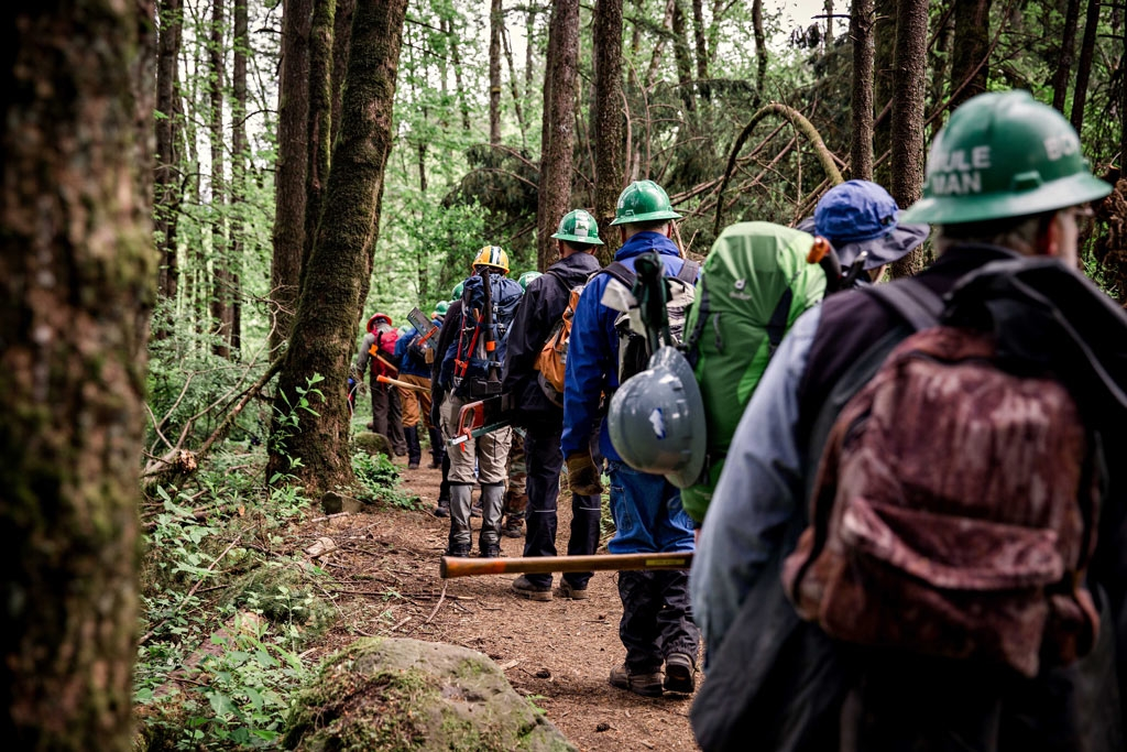 Volunteers learn how to use crosscut sawsto help keep the PCT open during our 2016 Trail Skills College in the Columbia River Gorge. Photo by Gray Feather Photography