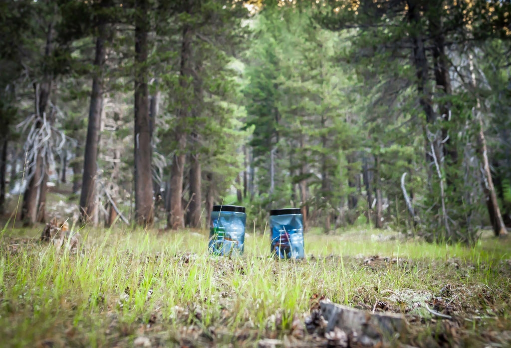 Bear canisters set out for the night away from camp. Photo by Martin Christian