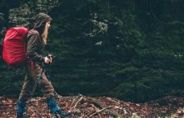 female hiker backpacking in the rain