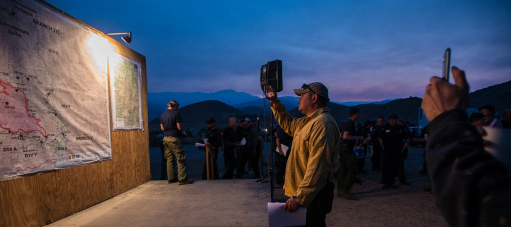 A morning meeting while fighting a fire on Sequoia National Forest. USDA Photo by Lance Cheung.