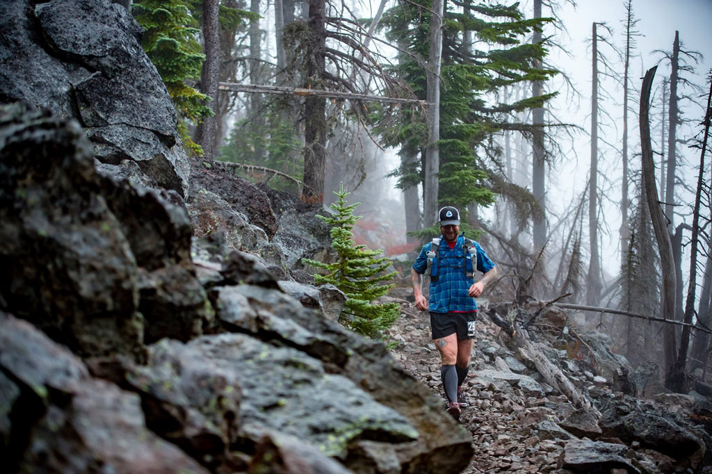 Lint trail during a hundred mile run. Note the tattoo. Photo by Paul Nelson