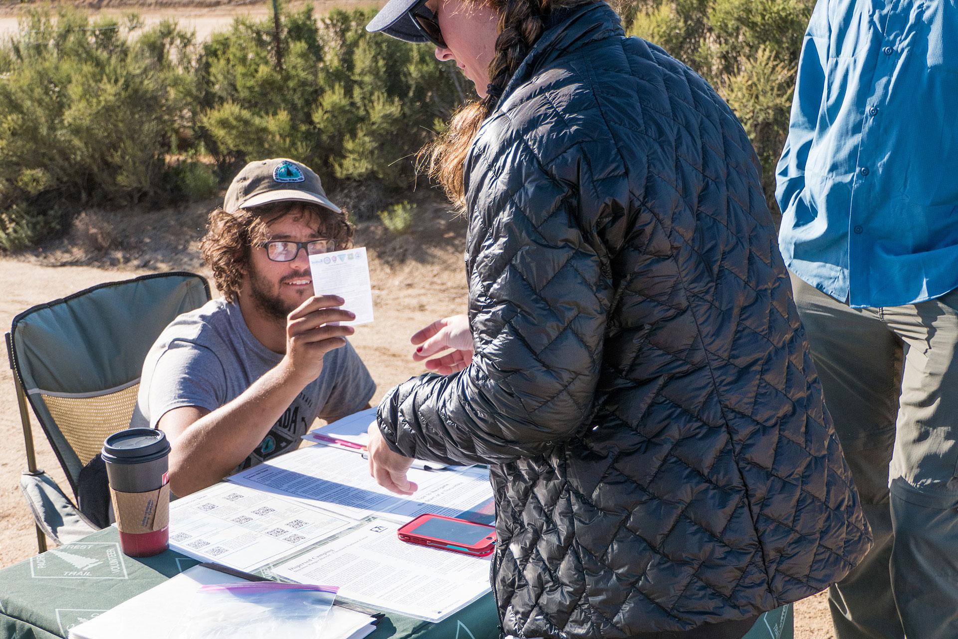 Tom checks a thru-hiker's permit.