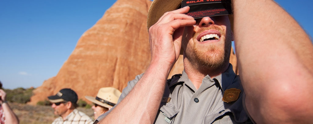 Rob Lorez watches a solar eclipse in Arches National Park in 2012. Photo by Andrew Kuhn of the National Park Service.