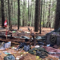 Forest Service personnel, joined by representatives of six federal and civilian partners, cleaned more than 6,000 lbs of trash and 7,000 lbs of irrigation pipes from an illegal marijuana cultivation site on the Lassen National Forest, Oct. 17-20, 2016. The site contained three large camps, numerous dumping locations and more than 1,250 lbs of fertilizer and pesticides. The cultivation operation was growing between 16,000 and 20,000 plants near the Pacific Crest Trail along Screwdriver Creek, a tributary of the Pit River which drains into the Shasta Lake Reservoir and the Sacramento River. Water diversion and contamination by pesticides from the site have adversely effected Screwdriver Creek. The Screwdriver Creek clean-up was part of a two-week operation, spearheaded by the Lassen National Forest, involving multiple grow sites. If the work being done were to be contracted, the cost would likely exceed $1 million. By managing the reclamation itself and enlisting help from partners, the Forest Service anticipated the cost to be closer to $250,000. Photo courtesy of U.S. Forest Service, Region 5