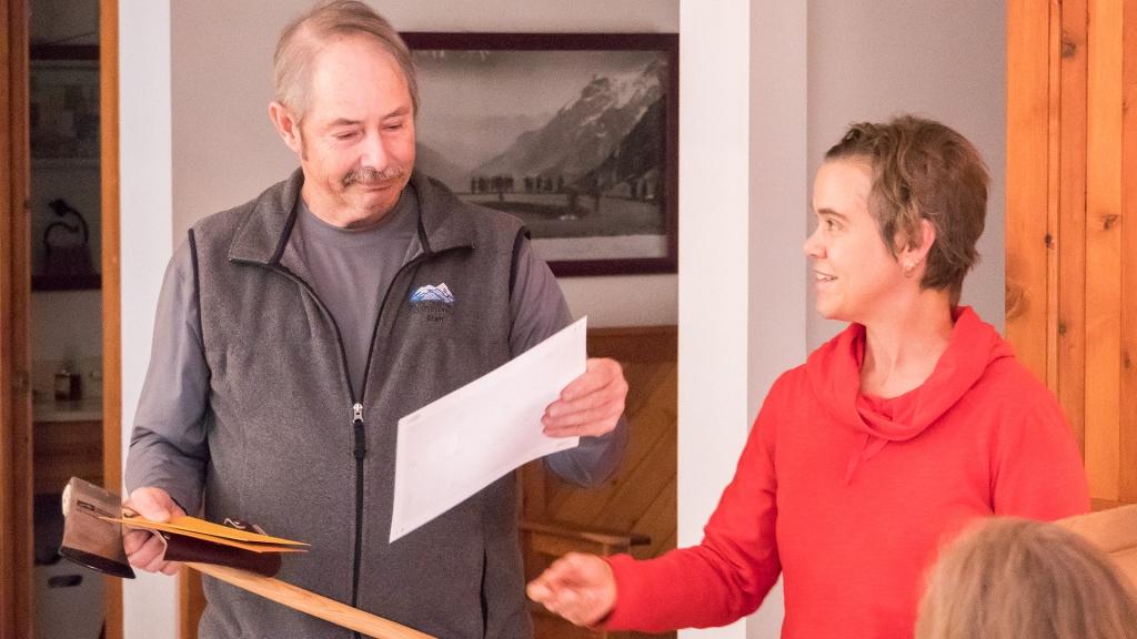 Retiring North Cascades Regional Representative Bill Hawley receives a parting gift from Columbia-Cascades Regional Representative Dana Hendricks.