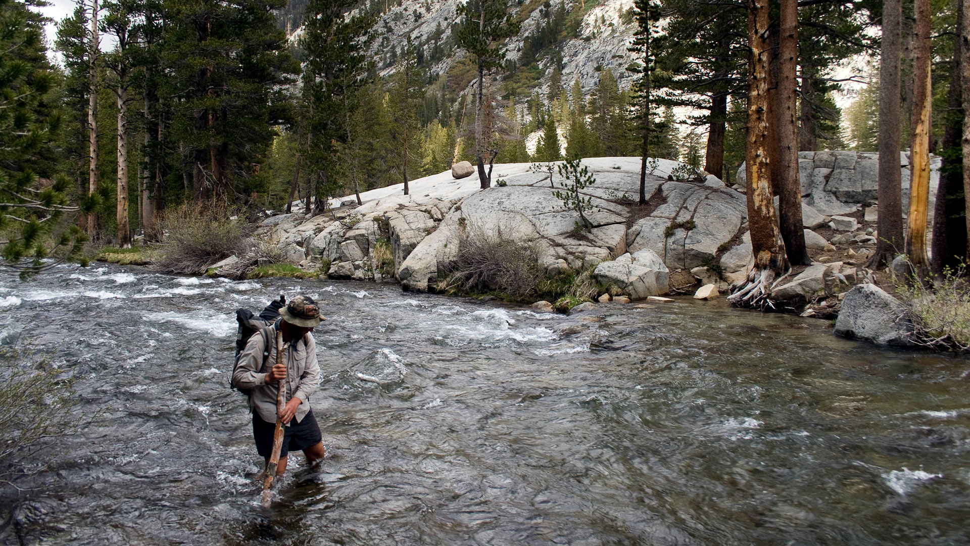Three points of contact while crossing a creek. Photo by Ryan Weidert.