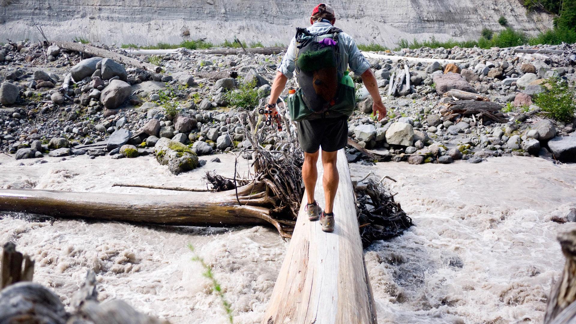 Crossing a creek on a log.