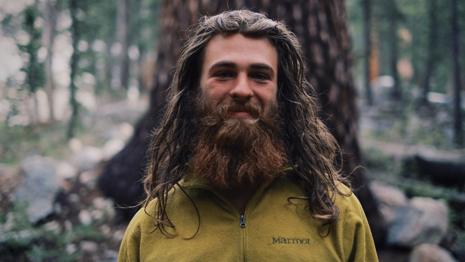 """Chris Pickering donated this photo of his friend Cap'n Crunch. And he wrote this great caption, """"This is Cap'n Crunch. He epitomizes the thru hiker in my opinion. Even swamped in mosquitos, he was still grinning ear to ear. We thru hiked the A.T. in 2012 not getting a chance to meet, only hearing of one another. And here, on the other side of the country in the middle of the forest surrounded by trees as thick as cars we were reunited much like a family would be. The thru hiking community is a tight knit group of people who are passionate about living and the relationships they make along the way. Our goal is not to run away, rather we are sprinting towards a lifestyle of exploration and the unknown. Why live in one place? There is far too much to see, learn, and experience to sit in one place for too long. Therefore, we hike."""""""