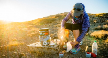 PCT hiker with a bear canister in the sierra
