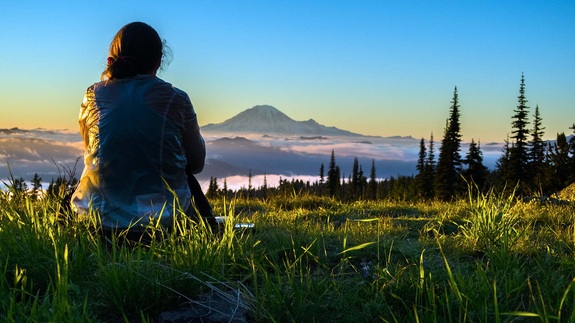 "Practice gratitude and kindness. Thousands will follow in your footsteps. ""CC' relaxes at the end of the day - enjoying the setting sun and view of Mt Rainier. Photo by Lisa Frugoli"
