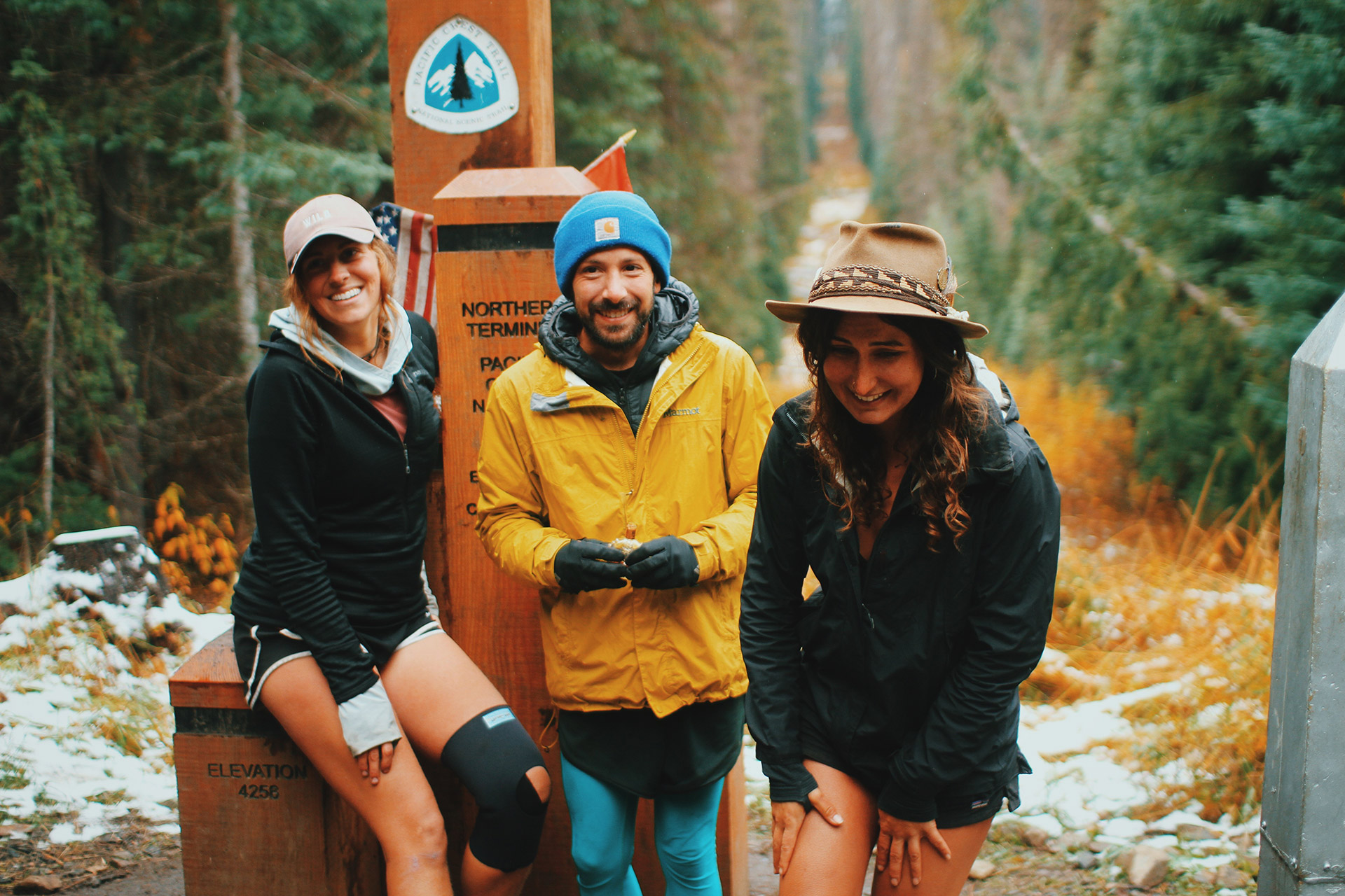 Blue, Twerk and Rumi standing at the Northern Terminus of the Pacific Crest Trail after walking a really long way. Photo courtesy of Tommy Corey.