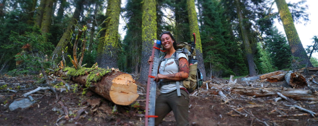 Former Trail Crew Technical Advisor Eleanore Anderson was all smiles with her crosscut saw.